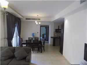 G.F furnished 2 BR with a terrace and back yard